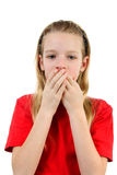Speak no evil. Young blonde girl covers her mouth: speak no evil, isolated on white background Stock Photo