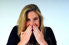 Speak no Evil. Woman with her hands over her mouth Stock Photo