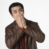 Speak no evil. Young Filipino man covers his mouth Royalty Free Stock Photos