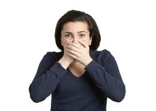 Speak no evil. Attractive young woman with hands over mouth speak no evil Royalty Free Stock Photography