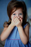 Speak no evil . Baby 3 years covers mouth with hands Stock Photography