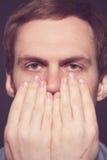 Speak no evil concept - Face of men covering his Stock Image