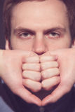 Speak no evil concept - Face of men covering his Royalty Free Stock Image