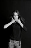Speak no evil. The girl closes your mouth Stock Images
