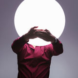 Speak no evil!. Man with big ball of light as a head in the speak no evil pose Stock Photography