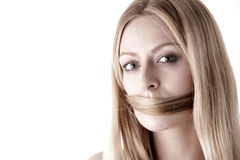 Speak no evil, silenced by own hair Royalty Free Stock Photography
