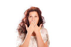 Speak no evil woman. Attractive middle aged woman covering her mouth with hands imitating the buddhistic monkey, speak no evil, isolated on white Stock Photo