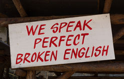 We speak perfect broken english Stock Images