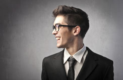 Speak up!. Smiling handsome young businessman talking stock photos