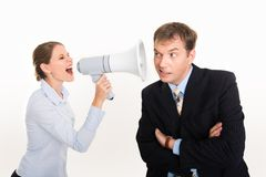Speak up. Image of businesswoman screaming by megaphone and businessman listening to her voice royalty free stock photo