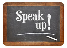 Speak up motivational phrase on blackboard Royalty Free Stock Images
