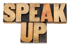 Speak up in wood type. Speak up - motivation concept - isolated text in letterpress wood type Royalty Free Stock Image
