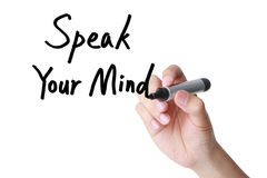 Speak Your Mind. Hand writing Feedback concept(Speak your mind) with black marker on transparent wipe board Stock Photos