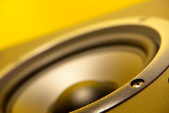Speaker. Close up with yellow cast Stock Photography
