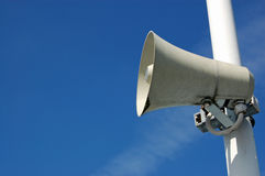 Speaker against a blue sky Royalty Free Stock Photo