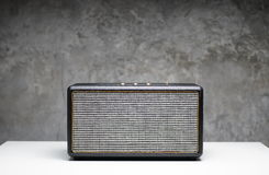 Speaker bluetooth on white table. And grey background Stock Image