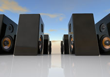 Speaker box. Render of a group of speaker boxes over a blue sky Royalty Free Stock Images
