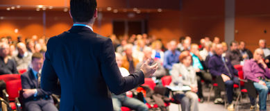 Speaker at Business Conference and Presentation. Audience at the conference hall Royalty Free Stock Image
