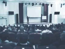 Speaker at Business Conference and Presentation. Audience the conference hall. stock photography