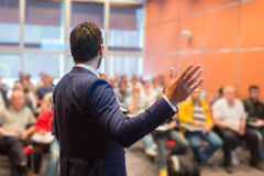 Speaker at Business Conference and Presentation. Speaker at Business Conference with Public Presentations. Audience at the conference hall. Entrepreneurship stock images