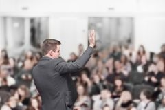 Speaker at a business conference with a public report stock photo