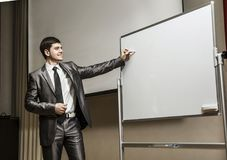 Speaker at business conferences standing in front of the Board for business presentations. Speaker at business conferences.business training and business Royalty Free Stock Photos