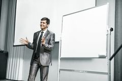 Speaker at business conferences standing in front of the Board for business presentations. Speaker at business conferences.business training and business Stock Photos