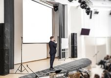 Speaker at business conferences standing in front of the Board for business presentations royalty free stock photo