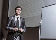 Speaker at business conferences standing in front of the Board for business presentations royalty free stock image