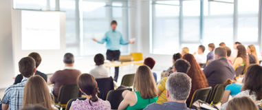 Speaker at Business convention and Presentation. royalty free stock image