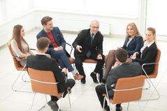 Speaker at a business meeting  answering a question from a parti. The boss meets with employees of the company Royalty Free Stock Image