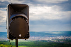 speaker with a city in background royalty free stock photo