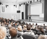 Speaker conducts the business conference for journalists and novice entrepreneurs royalty free stock photo