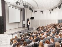 Speaker conducts the business conference for journalists and novice entrepreneurs royalty free stock images