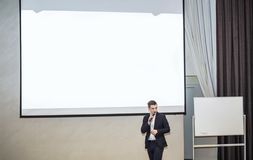Speaker conducts the business of the conference in the modern conference room royalty free stock photography