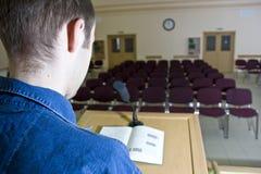 Speaker in empty auditorium Royalty Free Stock Image