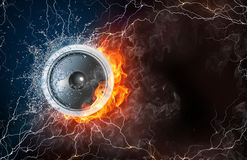 Speaker in fire and water. Speaker on fire and water with lightening around on black background. Horizontal layout with text space Royalty Free Stock Photos
