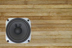 A speaker fixed on a wood board Stock Photo