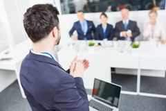 Speaker gives applause to all participants Royalty Free Stock Photo
