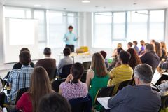 Speaker giving presentation on business conference. royalty free stock image