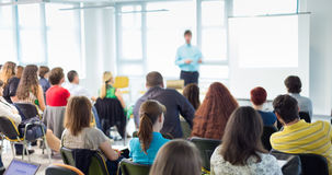 Speaker giving presentation on business conference. Business and entrepreneurship symposium. Speaker giving a talk at business meeting. Audience in conference Stock Photography