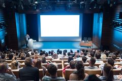 Free Speaker Giving Presentation On Health Care Conference. Stock Photos - 122838673