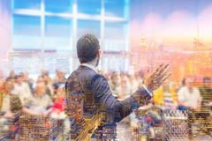 Speaker giving talk at Business Conference. Business meeting. Rear view of Speaker at Business Conference. Public Presentation. Audience at the conference hall stock image