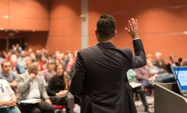 Public speaker giving talk at Business Event. stock photo
