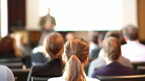 Public speaker giving talk at business event. stock video footage