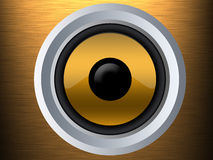 Speaker on a gold metal texture Stock Photography