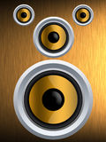 Speaker on a gold metal texture Stock Image
