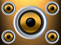 Speaker on a gold metal texture Royalty Free Stock Images
