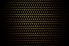 Speaker grille. Abstract background texture of a speaker grille made of perforated sheet metal Royalty Free Stock Image