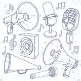 Speaker, horn, microphone and speaker surrounded by music notes Royalty Free Stock Photo